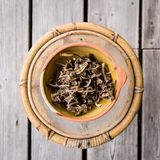 Dried chanterelles from above. Dried chantarelles in a bowl from above on wooden background stock photos