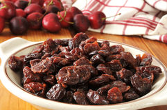 Dried cherries. A bowl of dried organic cherries on a rustic wooden table Royalty Free Stock Photo