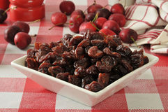 Dried cherries. A bowl of dried cherries on a picnic table Stock Images