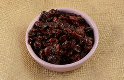Dried cherries. Coated in sunflower oil to preserve softness in pink condiment dish Stock Photos