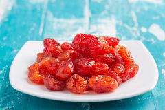 Dried Cherries Tomatoes Candied fruit. On rustic green wooden background Royalty Free Stock Image