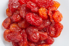 Dried Cherries Tomatoes Candied fruit. On rustic green wooden background Stock Photo