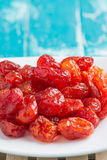 Dried Cherries Tomatoes Candied fruit. On rustic green wooden background Stock Images