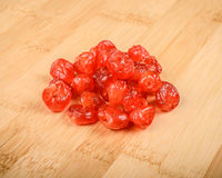 Dried cherries. On a wooden cutting board Royalty Free Stock Photography
