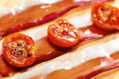 Dried cherry tomatoes with bacon. Selective focus. Close up view Stock Images