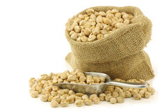Dried chick peas in a burlap bag Stock Image