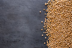 Dried chickpeas on dark surface with border. Top view Stock Images
