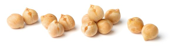 Closeup of dried chickpeas isolated on white. Dried chickpeas isolated on the white backgrounds Royalty Free Stock Images