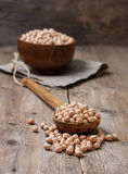Dried chickpeas in a wooden spoon Stock Photos