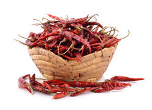 Dried chili in the basket on white background Stock Images