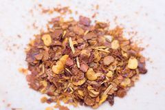 Dried chili flakes and seeds isolated on white background. royalty free stock photos