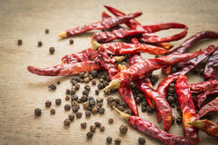 Dried chili peppers and black pepper stock image