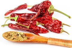 Dried chili peppers on a white background. Sales of exotic spices. Healthy raw food. Dried chili peppers on a white background. Sales of exotic spices. Healthy Stock Photo