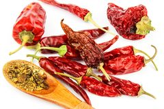 Dried chili peppers on a white background. Sales of exotic spices. Healthy raw food. Dried chili peppers on a white background. Sales of exotic spices. Healthy Royalty Free Stock Images