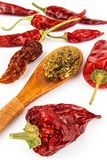 Dried chili peppers on a white background. Sales of exotic spices. Healthy raw food. Dried chili peppers on a white background. Sales of exotic spices. Healthy Royalty Free Stock Image