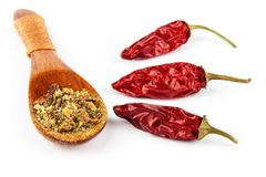 Dried chili peppers on a white background. Sales of exotic spices. Healthy raw food. Dried chili peppers on a white background. Sales of exotic spices. Healthy Royalty Free Stock Photography