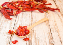 Dried chili peppers on wooden background Royalty Free Stock Image