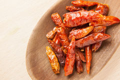 Dried chili peppers on a wooden spoon Stock Photography