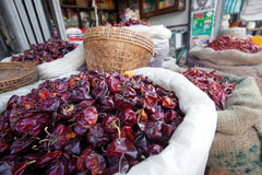 Dried chili in sacks in outdoor market Royalty Free Stock Photography