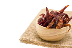 Dried chili in wooden bowl isolated on white background Royalty Free Stock Photos