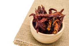 Dried chili in wooden bowl isolated on white background Royalty Free Stock Images