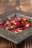 Dried chilies in a bowl. Dried red chili peppers in a bowl. Shallow dof Royalty Free Stock Images