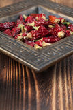 Dried chilies in a bowl. Dried red chili peppers in a bowl. Shallow dof Stock Photo
