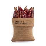 Dried Chilli. In gunny bag with white background stock photo