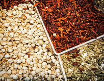 Dried chilli peppers with pistachios on the market place Stock Image