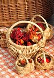 Dried chilli peppers in a wicker basket Stock Photo