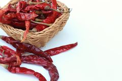 Dried chilli. Red dried chilli is in the wooden basket,which was isolated on white background Royalty Free Stock Image