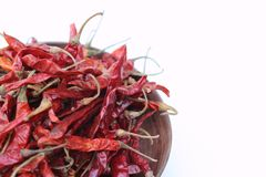 Dried chilli. Red dried chilli is in the wooden basket,which was isolated on white background Stock Photos