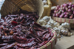 Dried Chillies. Dried Chilles with onion and garlic as background Stock Photography