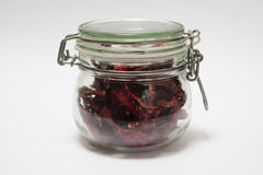 Dried chillies in a jar. Dried chillies in a glass jar against a white background Royalty Free Stock Photos