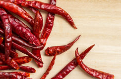 Dried chillies on wooden table Stock Photos
