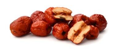 Dried chinese jujubes fruits on white. Chinese jujubes on white background Stock Photo