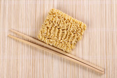 Dried chinese noodles and chopsticks Royalty Free Stock Photo