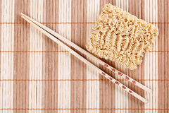 Dried chinese noodles and chopsticks Royalty Free Stock Images