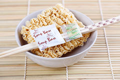 Dried chinese noodles and chopsticks Royalty Free Stock Photos