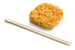 Dried chinese noodles with chopsticks Royalty Free Stock Photos