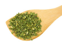 Dried chopped chives in wood spoon Stock Images
