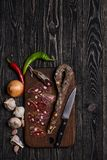 Dried chorizo sausage on wooden board Stock Images