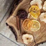 Dried chunks of fruit on wooden background. Pieces of dried fruits on wooden background Royalty Free Stock Photos
