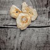 Dried chunks of fruit on wooden background. royalty free stock photography