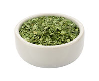 Dried Cilantro in a Bowl isolated Stock Images