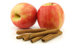 Dried cinnamon sticks and fresh apples Royalty Free Stock Image