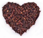 Dried clove in the form of heart on a white Stock Images