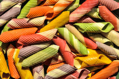 Dried colorful italian pasta background Stock Photo