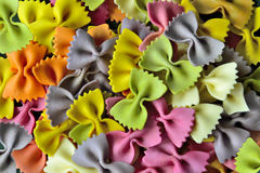 Dried colorful italian pasta farfalle or bows background Stock Photo
