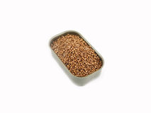 Dried coriander seeds in can Stock Images